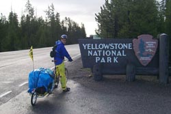 Kristofer Yahner at the Yellowstone entrace sign